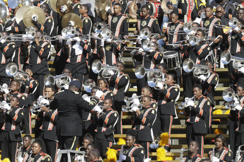 FILE - In this Sept. 5, 2015, file photo, Grambling State's marching band performs during the first half of an NCAA college football game against California in Berkeley, Calif. HBCUs in the Southwestern Athletic Conference have fared well economically so far despite the shutdown of sports because of the new coronavirus. But these programs could take a huge financial hit if fans are banned from football games this fall because of the pandemic. (AP Photo/Ben Margot, File)