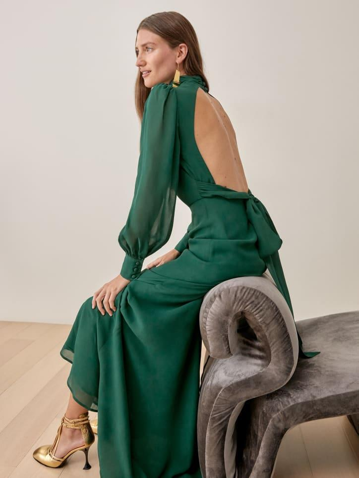 """<br><br><strong>Reformation</strong> Midleton Dress, $, available at <a href=""""https://go.skimresources.com/?id=30283X879131&url=https%3A%2F%2Fwww.thereformation.com%2Fproducts%2Fmidleton-dress%3Fcolor%3DEmerald"""" rel=""""nofollow noopener"""" target=""""_blank"""" data-ylk=""""slk:Reformation"""" class=""""link rapid-noclick-resp"""">Reformation</a>"""