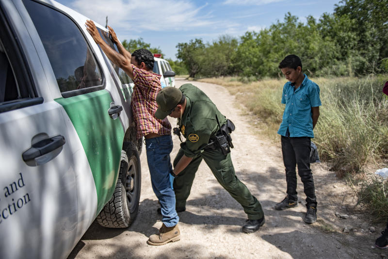 Border Patrol agent Roy Ramirez searches an illegal immigrant