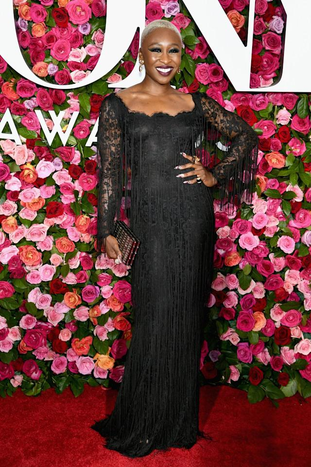 <p>In a vintage gown, Fred Leighton jewels, and Sophie Webster shoes. <br></p>