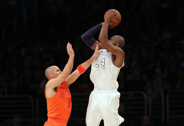 Kobe Bryant shoots a jumper against Jason Kidd and the Knicks in December 2012. (Photo by Victor Decolongon/Getty Images)