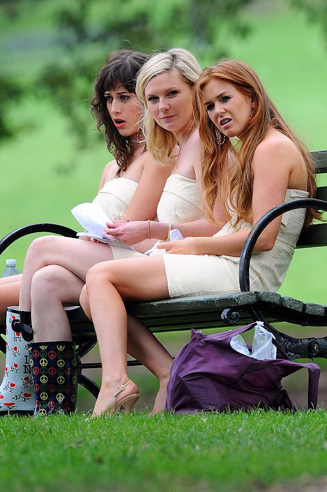 """It might look like a scene out of """"Bridesmaids 2,"""" but (L-R) Lizzy Caplan, Kirsten Dunst, and Isla Fisher were actually shooting a different flick called """"The Bachelorette"""" in Brooklyn, New York, on Wednesday. The film, which also stars James Marsden, focuses on three women who are asked to be bridesmaids in a high school classmate's wedding. Hmm, sounds like another movie we know! Doug Meszler/<a href=""""http://www.splashnewsonline.com"""" target=""""new"""">Splash News</a>"""
