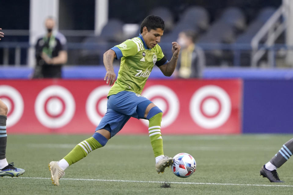 Seattle Sounders forward Raul Ruidiaz drives against Minnesota United during the first half of an MLS soccer match Friday, April 16, 2021, in Seattle. (AP Photo/Ted S. Warren)