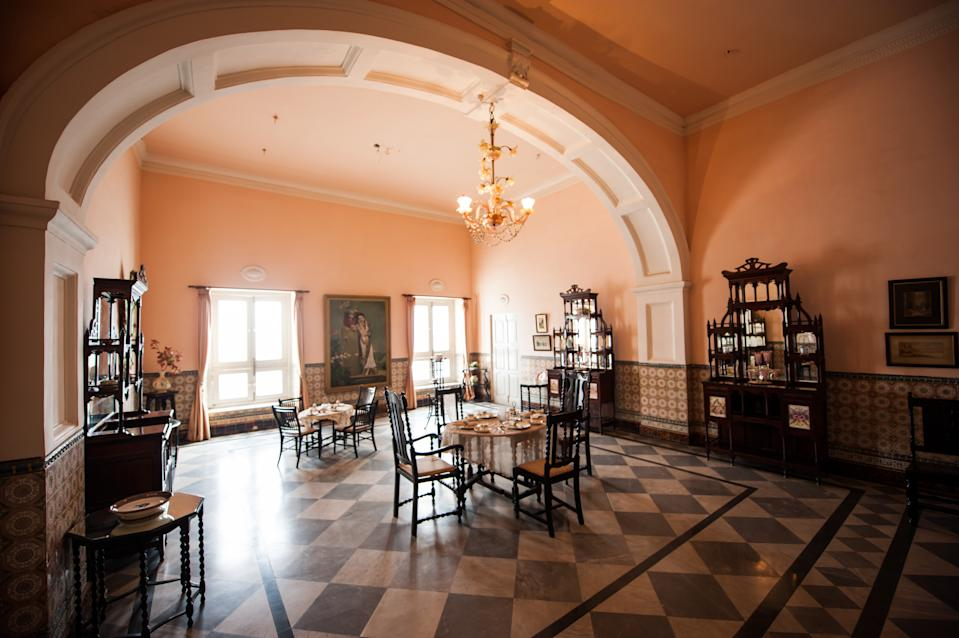 A tearoom inside the Jai Vilas Palace. The Jai Vilas Mahal was established in 1874 by Jayajirao Scindia, the Maharaja of Gwalior. (Photo by Atid Kiattisaksiri/LightRocket via Getty Images)
