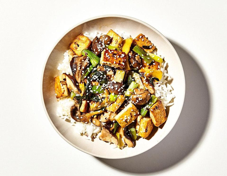 "If you have a bit of extra time before making this stir-fry recipe, press the whole block of tofu between two layers of paper towels, weighted down with a couple of large cans, for 15 minutes. Removing that excess water helps the tofu get extra crispy as it cooks. <a href=""https://www.bonappetit.com/recipe/tofu-and-mushroom-stir-fry?mbid=synd_yahoo_rss"" rel=""nofollow noopener"" target=""_blank"" data-ylk=""slk:See recipe."" class=""link rapid-noclick-resp"">See recipe.</a>"