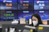 A currency trader watches monitors at the foreign exchange dealing room of the KEB Hana Bank headquarters in Seoul, South Korea, Thursday, June 24, 2021. Shares were mostly higher in Asia on Thursday after a listless day of trading on Wall Street as the recent bout of nerves over Federal Reserve policy fades. (AP Photo/Ahn Young-joon)