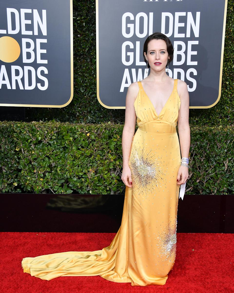 <p>On January 6, Claire Foy delivered one of her greatest looks to date in a silky Miu Miu dress. <em>[Photo: Getty]</em> </p>