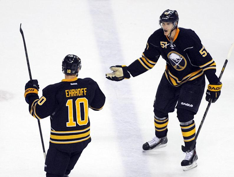Buffalo Sabres' Christian Ehrhoff (10) celebrates his game-winning goal with Tyler Myers during the overtime session of an NHL hockey game against the Toronto Maple Leafs in Buffalo, N.Y., Friday, Nov. 29, 2013. Buffalo won 3-2 in overtime. AP Photo/Gary Wiepert)