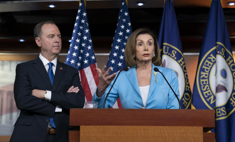 Speaker of the House Nancy Pelosi, D-Calif., is joined by House Intelligence Committee Chairman Adam Schiff, D-Calif., at a news conference as House Democrats move ahead in the impeachment inquiry of President Trump, at the Capitol in Washington this week. (Photo: J. Scott Applewhite/AP)