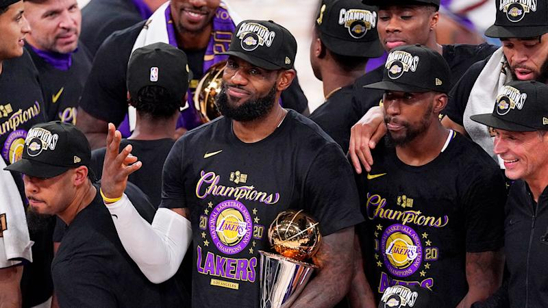 Seen here, LeBron James poses with his trophy after winning the 2020 NBA championship.