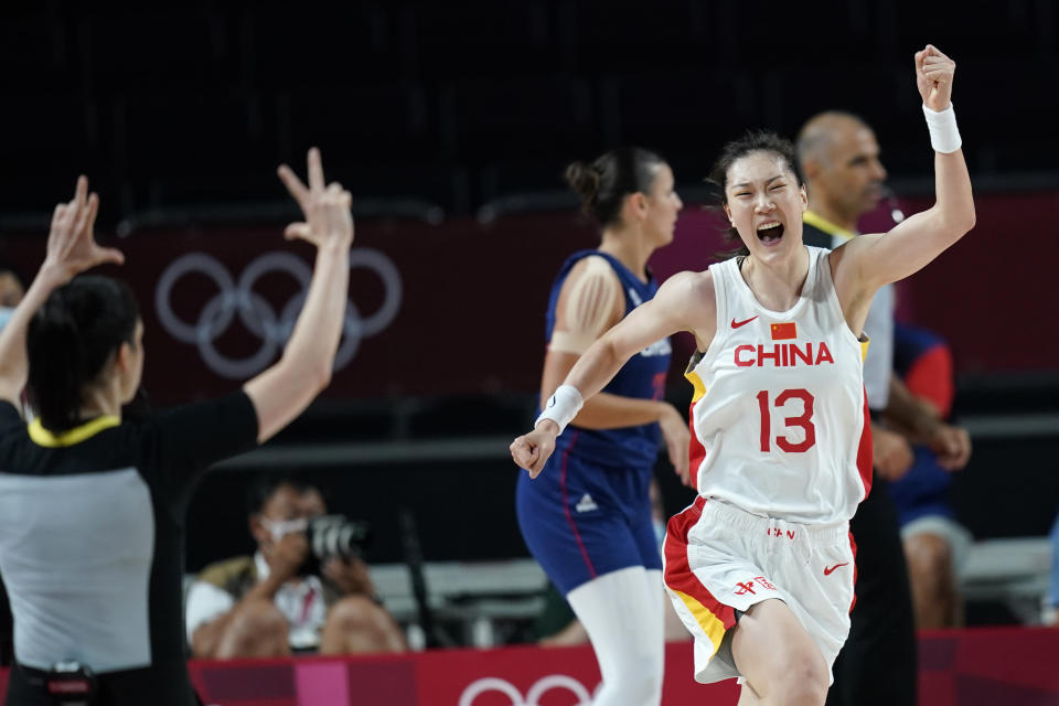 China's Mengran Sun (13) celebrates after making a 3-point basket during a women's basketball quarterfinal round game against Serbia at the 2020 Summer Olympics, Wednesday, Aug. 4, 2021, in Saitama, Japan. (AP Photo/Charlie Neibergall)