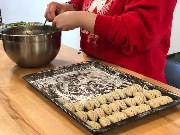 Anne Huang prepares dumplings for her business, Anne's Dumplings. It's one of four food-based businesses that have set up in a new space in Whitehorse's industrial area. (George Maratos/CBC - image credit)