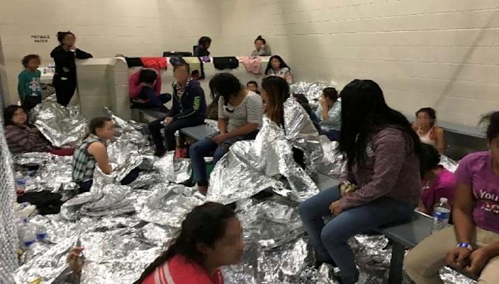 An overcrowded area holding families at a Border Patrol Centralized Processing Center is seen in a still image from video in McAllen, Texas, U.S. on June 11, 2019 and released as part of a report by the Department of Homeland Security's Office of Inspector General on July 2, 2019. Picture pixelated at source. (Photo: Office of Inspector General/DHS/Handout via Reuters)