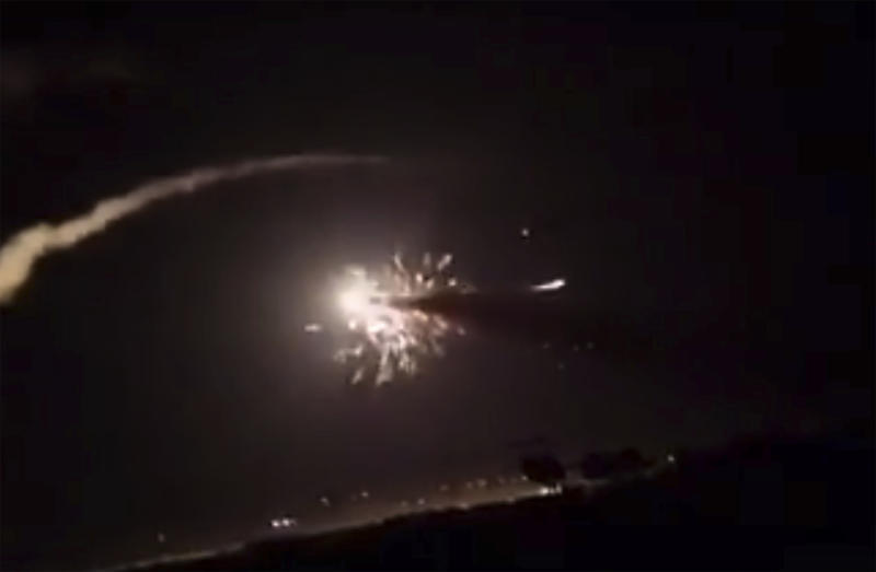 This frame grab from a video provided by the Syrian official news agency SANA shows missiles flying into the sky near Damascus, Syria, Tuesday, Dec. 25, 2018. Israeli warplanes flying over Lebanon fired missiles toward areas near the Syrian capital of Damascus late Tuesday, hitting an arms depot and wounding three soldiers, Syrian state media reported, saying that most of the missiles were shot down by air defense units. (SANA via AP)