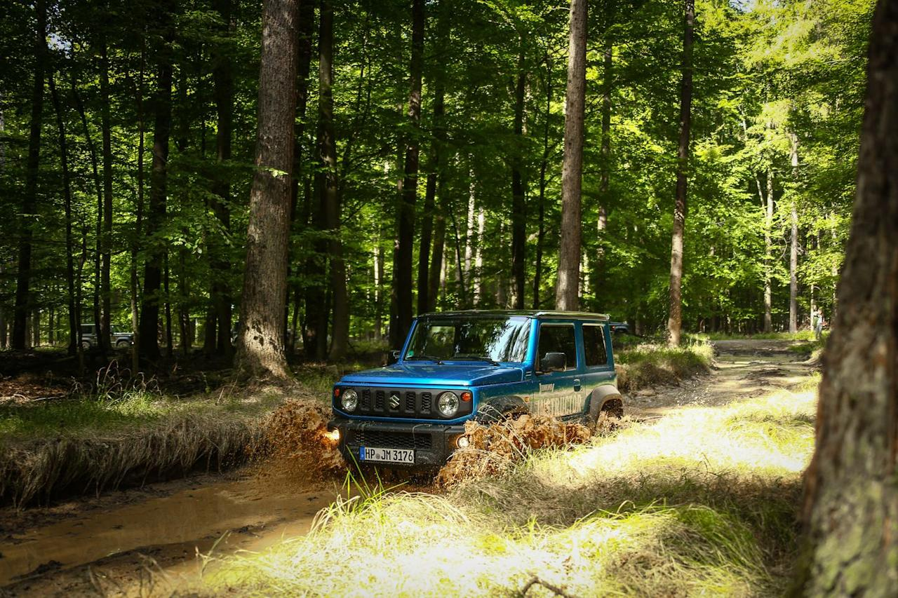 <p>The placement of the Jimny's headlights and turn signals harkens back to the first-generation model that debuted for 1970.</p>