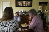 Jo Stanko, center, meets with her son Pat Stanko, right, and daughter-in-law Jan Stanko, left, to discuss their options for buying supplemental cattle feed, Wednesday, July 14, 2021, at their ranch near Steamboat Springs, Colo. Feed prices are high, and due to drought conditions this year, Jo's husband, Jim Stanko, says if the family can't harvest enough hay to feed their cattle, they may need to sell off some of their herd. (AP Photo/Brittany Peterson)