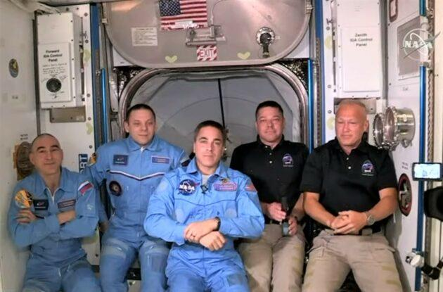 Space station and Crew Dragon astronauts