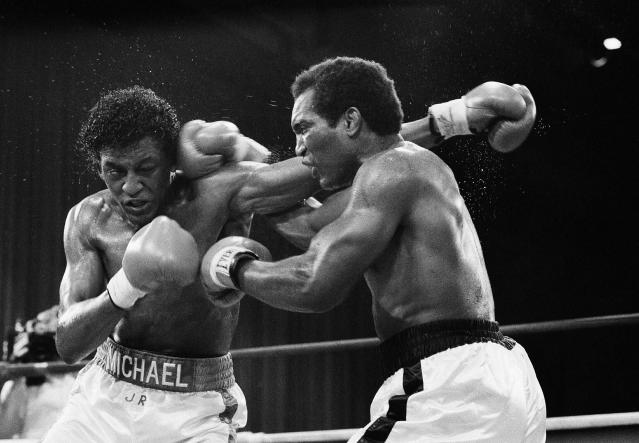 "FILE - In this June 5, 1986, file photo, Michael Olajide, left, from Canada, exchanges punches with Pandy Smith, of Chicago, during the sixth round of a middleweight fight at Madison Square Garden in New York. When actor Chris Hemsworth sought ""experts"" to contribute to a fitness and health app called Centr, one place he turned was to the boxing ring. He found Olajide Jr., a former middleweight contender who literally lost an eye to his sport. (AP Photo/Wilbur Funches, File)"