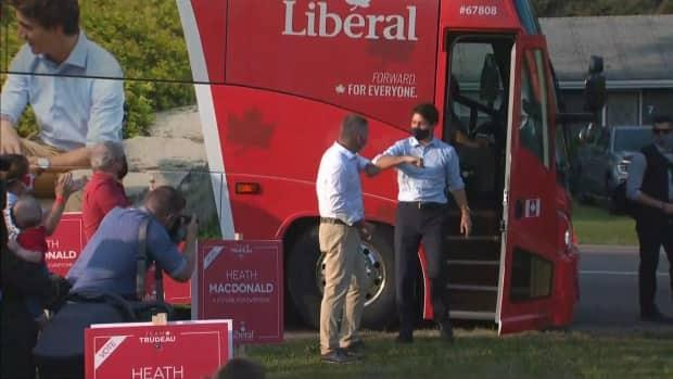 Liberal candidate Heath MacDonald greets Justin Trudeau as he steps off the bus in Cornwall Sunday. (CBC - image credit)