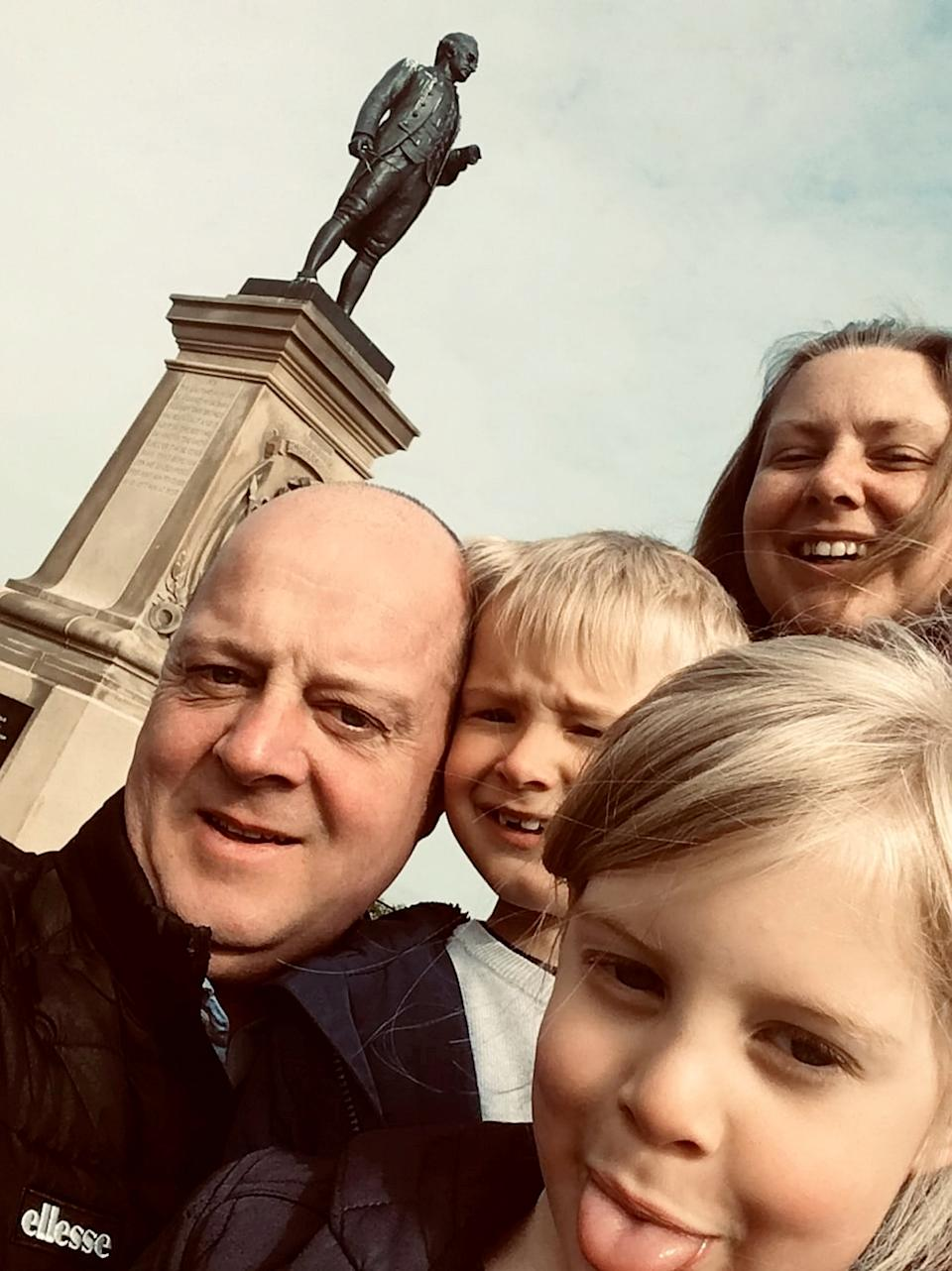 Justin Bowen and his wife Helga Peeters with children Bren, seven, and Seren, nine. (SWNS)