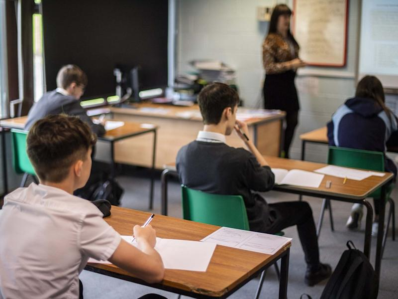 Pupils sit apart during a socially distanced language lesson at Longdendale High School: Getty Images