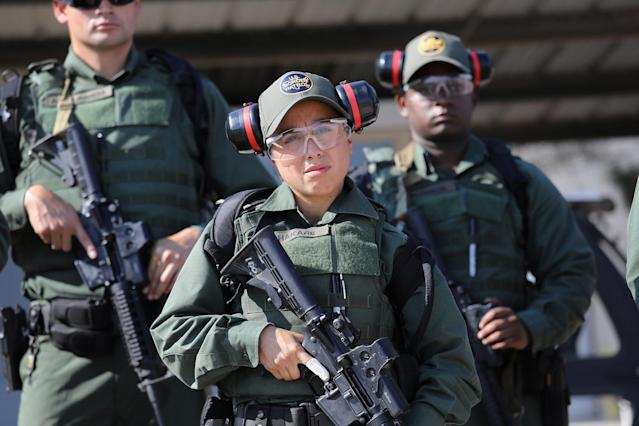 <p>U.S. Border Patrol trainee Stevany Shakare, 24, takes part in a weapons training class at the U.S. Border Patrol Academy on August 3, 2017 in Artesia, N.M. Shakare immigrated to Michigan with her family from Iraq in 2004, fleeing violence after the U.S. invasion. (Photo: John Moore/Getty Images) </p>