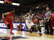Cincinnati guard Kevin Johnson (25) drives to the basket against Stony Brook guard Deshaun Thrower (1) in the first half of an NCAA college basketball game, Tuesday, Dec. 2, 2014, in Cincinnati. (AP Photo/Frank Victores)