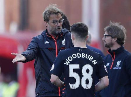 Britain Football Soccer - Stoke City v Liverpool - Premier League - bet365 Stadium - 8/4/17 Liverpool manager Juergen Klopp speaks with Ben Woodburn Action Images via Reuters / Carl Recine Livepic