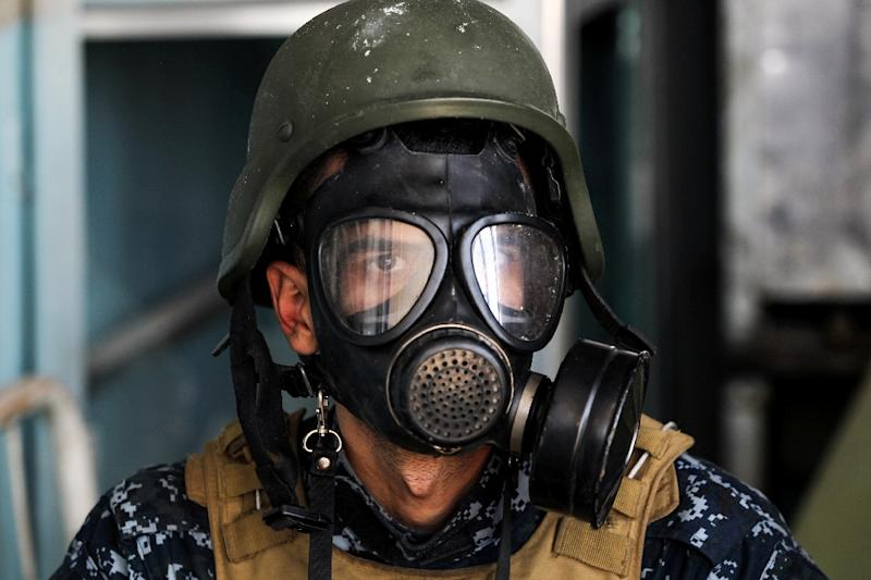 A member of the Iraqi forces wears a gas mask during an offensive to recapture Mosul from Islamic State group. Gas masks and bullet-proof vests as classified as war weapons in Thailand