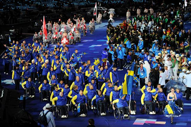LONDON, ENGLAND - AUGUST 29: Shooter Jonas Jacobsson of Sweden carries the flag during the Opening Ceremony of the London 2012 Paralympics at the Olympic Stadium on August 29, 2012 in London, England. (Photo by Gareth Copley/Getty Images)