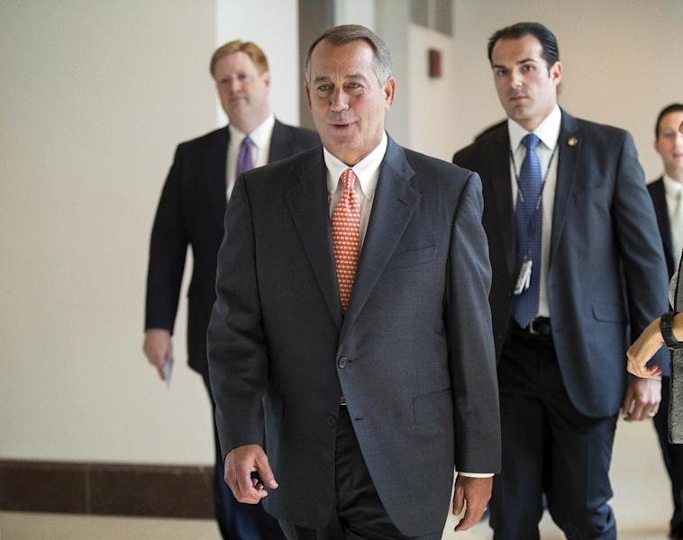 Speaker of the House John Boehner, R-Ohio, returns to his office after speaking with reporters about the deadline to fund the government and the fight among House Republicans, on Capitol Hill in Washington, Thursday, Sept. 19, 2013. House Republicans vowed Wednesday to pass legislation that would prevent a partial government shutdown and avoid a default while simultaneously canceling out President Barack Obama's health care overhaul, inaugurating a new round of political brinkmanship as critical deadlines approach. (AP Photo/J. Scott Applewhite)