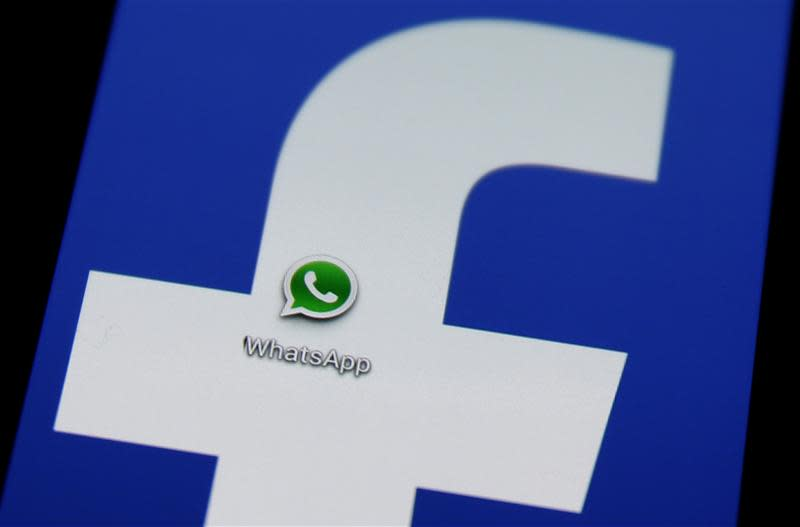 A Whatsapp icon is seen on a Samsung Galaxy S4 phone screen with a Facebook logo in the central Bosnian town of Zenica