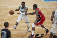 Charlotte Hornets guard Terry Rozier (3) is defended by New Orleans Pelicans guard Eric Bledsoe (5) during the second half of an NBA basketball game Sunday, May 9, 2021, in Charlotte, N.C. (AP Photo/Brian Westerholt)