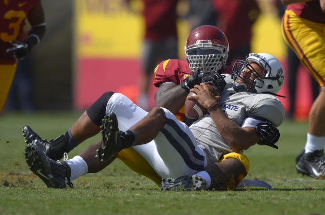 Utah State quarterback Chuckie Keeton, right, is sacked by Southern California defensive end George Uko during the first half of an NCAA college football game on Saturday, Sept. 21, 2013, in Los Angeles. (AP Photo/Mark J. Terrill)