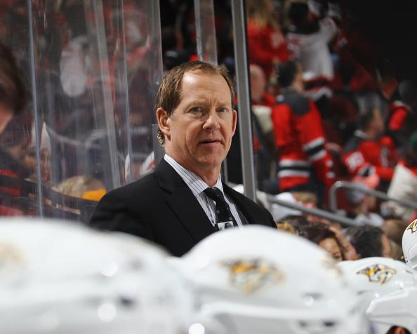 "NEWARK, NJ – DECEMBER 20: Assistant coach Phil Housley of the <a class=""link rapid-noclick-resp"" href=""/nhl/teams/nas/"" data-ylk=""slk:Nashville Predators"">Nashville Predators</a> works the game against the <a class=""link rapid-noclick-resp"" href=""/nhl/teams/njd/"" data-ylk=""slk:New Jersey Devils"">New Jersey Devils</a> at the Prudential Center on December 20, 2016 in Newark, New Jersey. The Predators defeated the Devils 5-1. (Photo by Bruce Bennett/Getty Images)"