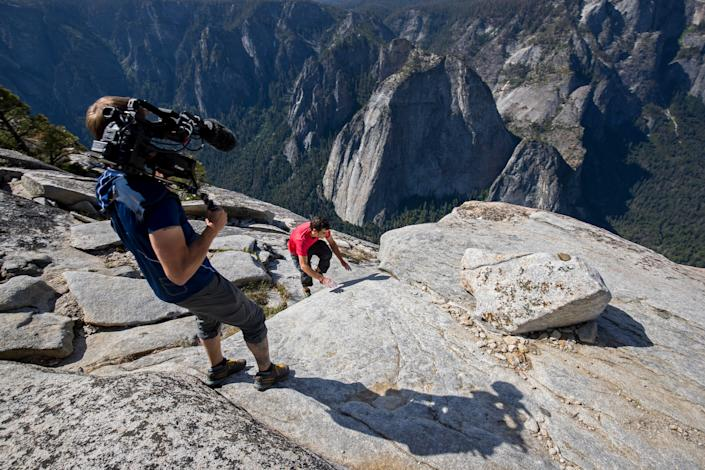 """Clair Popkin, director of photography on """"Free Solo,"""" gets a shot of Alex Honnold as he nears the top of the wall."""