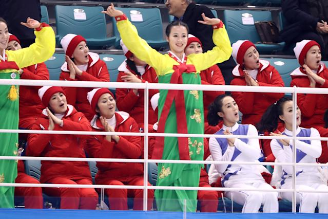 <p>North Korean cheerleaders sing and wave during the Women's Ice Hockey Preliminary Round – Group B game between Switzerland and Korea on day one of the PyeongChang 2018 Winter Olympic Games at Kwandong Hockey Centre on February 10, 2018 in Gangneung, South Korea. (Photo by Ronald Martinez/Getty Images) </p>