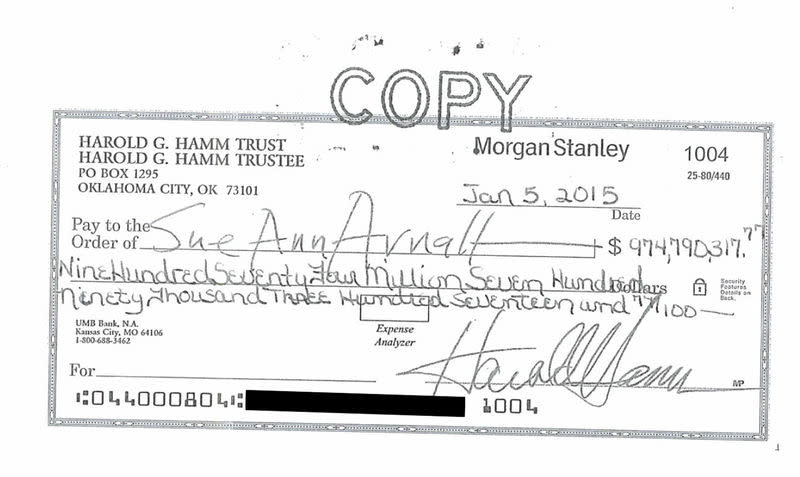 A divorce settlement check from Harold Hamm chief executive of oil driller Continental Resources to ex-wife Sue Ann Arnall in the amount of $974.8 million is seen in this handout image