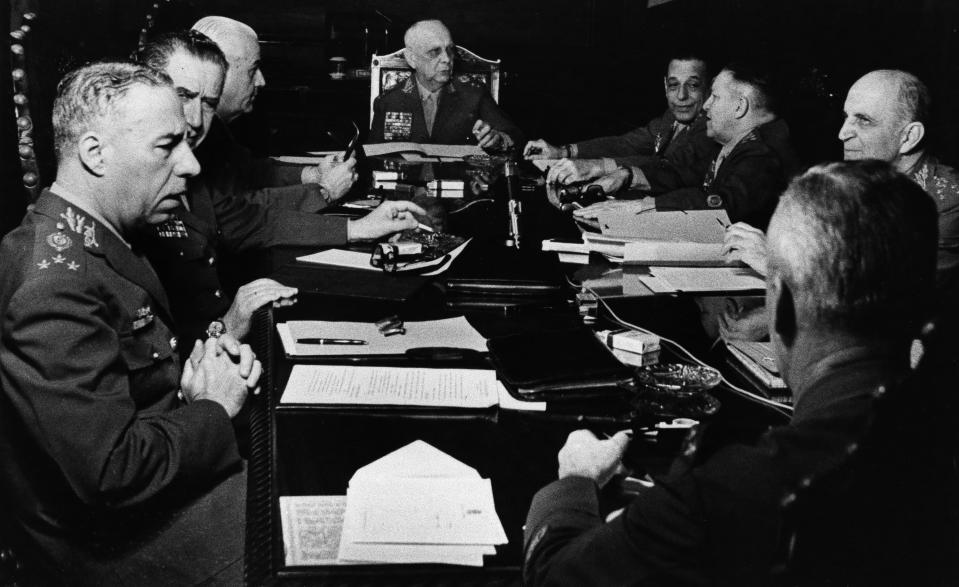 Top Brazilian army chiefs meet in Rio de Janeiro, Sept. 16, 1969, to find a way out of the political stalemate created by President Arthur da Costa e Silva's illness. From left are Generals Jurandir de Bizzarria Mamed, Syzeno Sarmento, Antonio C. Muricy, Army Minister Gen. Aurelio Lyro Tavares, Alfredo Soutp Malan, Emelio Garrastazu Medici and Olivio Vieira Filho. General with back to camera is unidentified. (AP Photo)