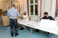 People vote as the polling stations open in the morning during the municipal elections at Finnoo school in Espoo, Finland on Sunday, June 13, 2021.(Mikko Stig/Lehtikuva via AP)