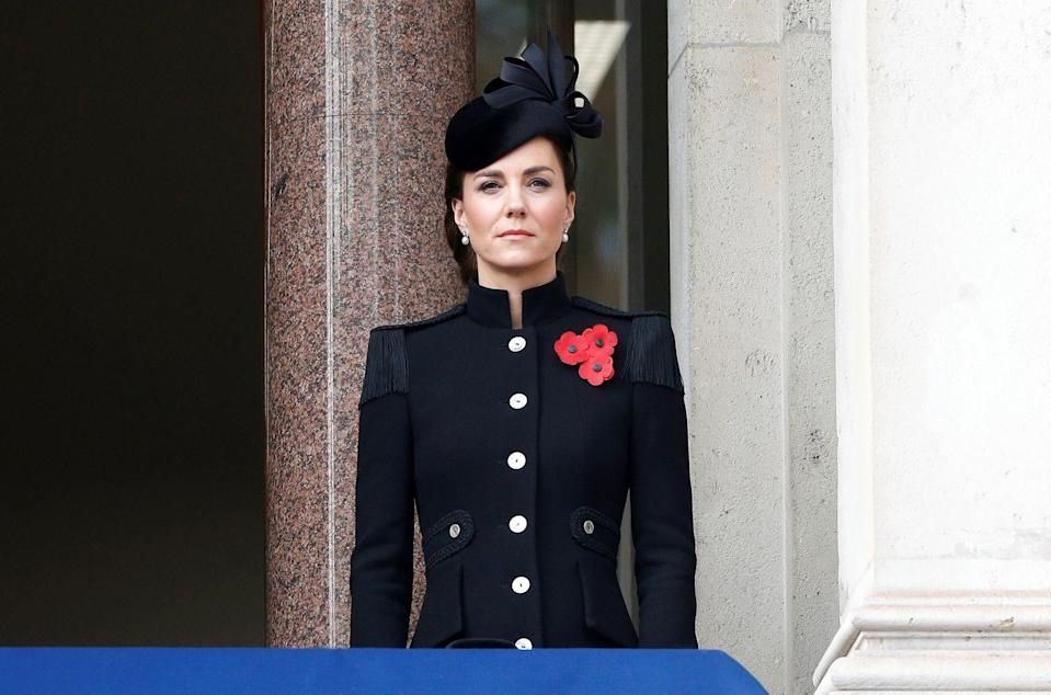 """<p>At the annual <a href=""""https://www.townandcountrymag.com/society/tradition/g34610029/queen-elizabeth-royal-family-remembrance-sunday/"""" rel=""""nofollow noopener"""" target=""""_blank"""" data-ylk=""""slk:Remembrance Sunday ceremony"""" class=""""link rapid-noclick-resp"""">Remembrance Sunday ceremony</a>, the Duchess of Cambridge wore an all-black outfit, keeping with tradition. Her detailed coat was a custom Alexander McQueen and the hat from famed milliner Philip Treacy. </p>"""