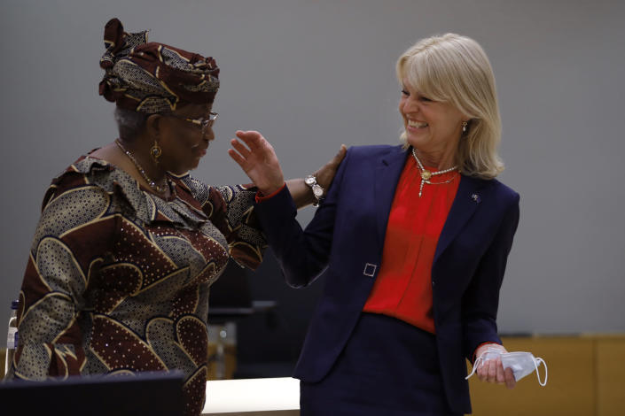 World Trade Organization Director-General Ngozi Okonjo-Iweala, left, talks to Sweden's Foreign Trade Minister Anna Hallberg during a European Foreign Trade ministers meeting at the European Council headquarters in Brussels, Thursday, May 20, 2021. (AP Photo/Francisco Seco, Pool)