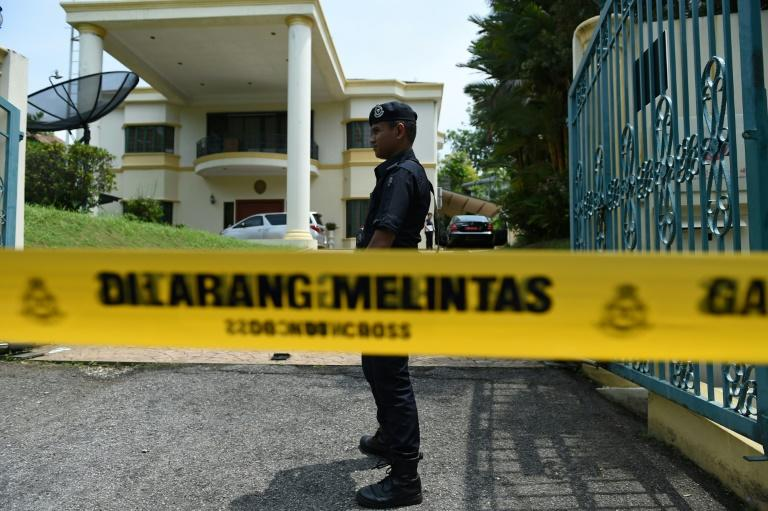 Malaysian police cordon off the North Korean embassy in Kuala Lumpur on March 7, after the Malaysian government said embassy staff were barred from leaving the country