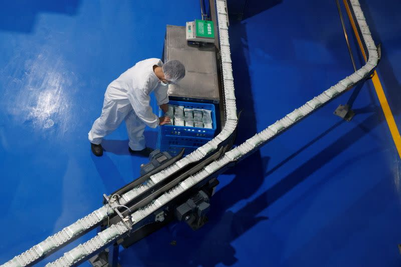 FILE PHOTO: A worker is seen during a government-organized tour of the Mengniu Dairy factory in Beijing