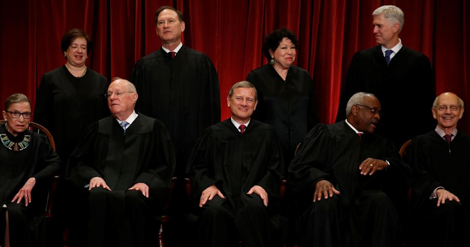 U.S. Chief Justice John Roberts (seated C) leads Justice Ruth Bader Ginsburg (front row, L-R), Justice Anthony Kennedy, Justice Clarence Thomas, Justice Stephen Breyer, Justice Elena Kagan (back row, L-R), Justice Samuel Alito, Justice Sonia Sotomayor, and Justice Neil Gorsuch in taking a new family photo including Gorsuch, their most recent addition, at the Supreme Court building in Washington, D.C., U.S., June 1, 2017.