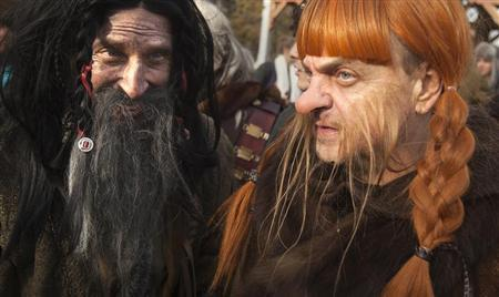 """People dressed up as dwarves film a promotional video for the """"The Hobbit: The Desolation of Smaug"""" at Belvedere Castle in Central Park, New York"""