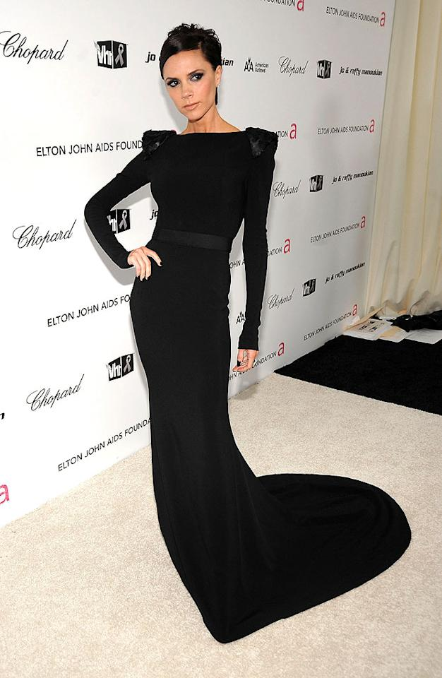 """Posh popped a pose at the Elton event in one of her very own pieces, a dramatic black jersey dress with sequined shoulders. Jamie McCarthy/<a href=""""http://www.wireimage.com"""" target=""""new"""">WireImage.com</a> - February 22, 2009"""