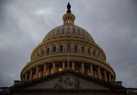 The U.S. Capitol building is lit at dusk ahead of planned votes on tax reform in Washington