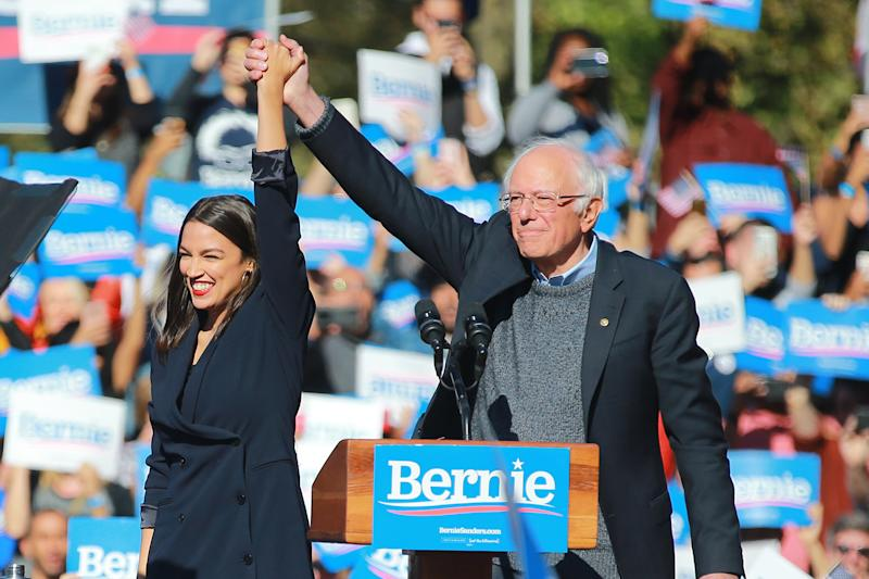 U.S. Representative Alexandria Ocasio-Cortez, Democrat of New York, stand on stage with Vermont senator and Democratic presidential candidate Bernie Sanders at the Bernie's Back Rally in Long Island City, New York on Saturday, Oct. 19, 2019. (Photo: Gordon Donovan/Yahoo News)