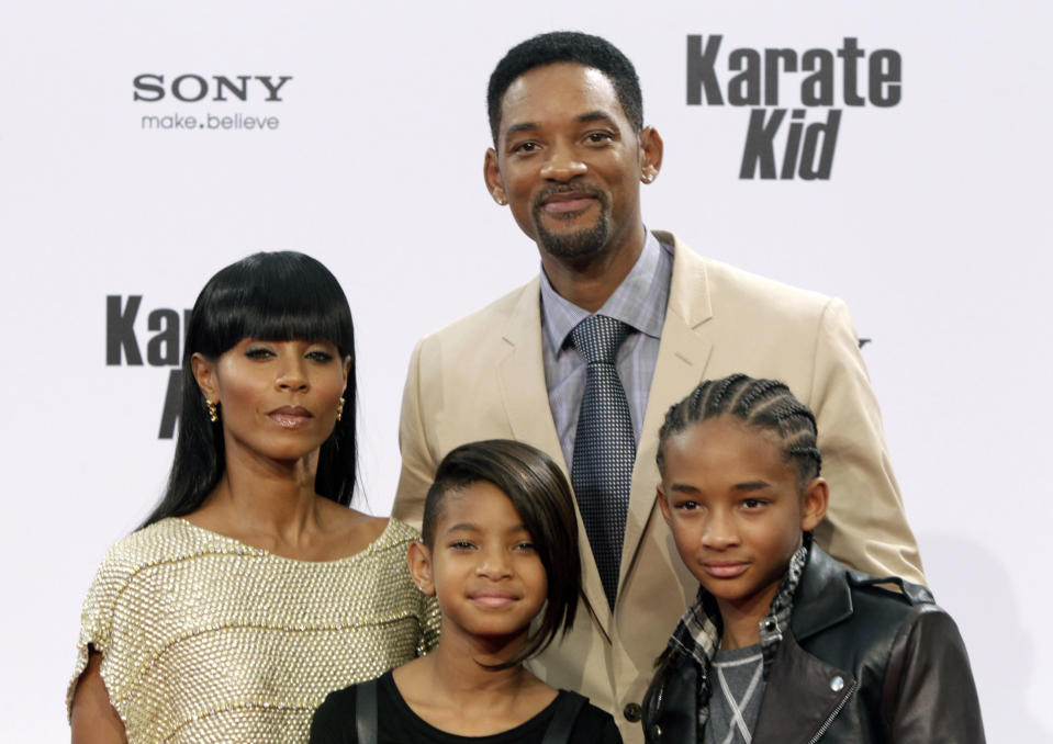 "U.S. actor and producer Will Smith poses for photographers with his wife Jada Pinkett Smith (L) and their children Jaden (R) and Willow as they arrive for the premiere of ""The Karate Kid"" in Berlin, July 19, 2010. The movie opens in German cinemas on July 22.     REUTERS/Tobias Schwarz     (GERMANY - Tags: ENTERTAINMENT)"